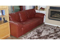 Three seater burgundy leather sofa and matching chair