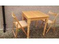 pine table and 2 folding chairs