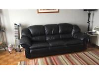 Pair of used leather sofas
