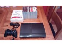 PS3 SUPER SLIM WITH 2 SINGSTAR MICS AND 14 GAMES