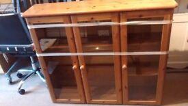 Kitchen or diner wall cupboard antique pine, glass doors, lighting slim but wide