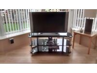 31 inch Goodmans television and smoke glass stand