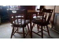 PINE ROUND TABLE AND 4 CHAIRS