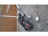 full set of golf clubs and trolly