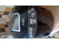 Good condition hardly used RUSSELL HOBBS bread maker, comes with instruction booklet aswell