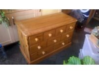 Solid pine chest with 9 drawers.
