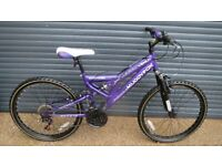 MUDDY FOX SUSPENSION BIKE IN EXCELLENT LITTLE USED CONDITION.. (SUIT APPROX. AGE. 9+)..