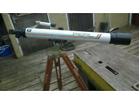 telescope with wooden tripod
