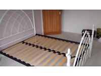 pretty cream Gothic style metal frame double bed