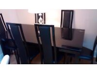 beautiful high gloss dining table and 6 chairs
