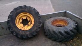 2 wheel rims for a dumper