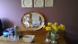Lovely oval gold leaf type mirror for sale