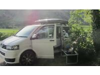 White Volkswagen VW T5 Day van conversion with rock roll bed and tent top roof box sleeps 4/5