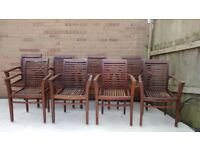 Eight solid teak chairs for sale