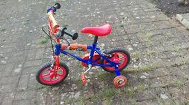 Boys bike with stabelisers