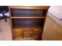 Old, solid wood book case/display cabinet. Very decorative carved detail.