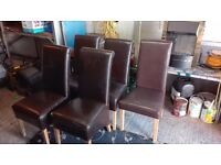5 Brown leather chairs