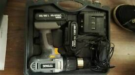 Titan cordless drill with 2 batteries charger