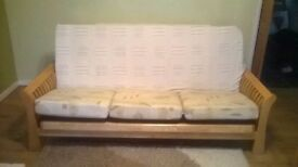 Futon bed folds out to a double bed with mattress