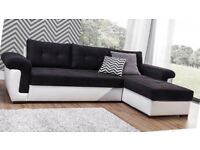 BRAND NEW CORNER SOFA BED—BLACK AND WHITE—-