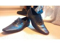 Unisex black leather shoes size 7