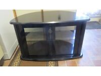 TV cabinet stand with toughened glass doors & shelf.