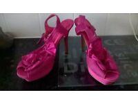 worn pink very high heel shoes