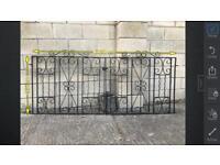 Pair of metal gates