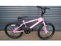 GIRLS APOLLO AVAGO BMX. BIKE IN VERY GOOD LITTLE USED CONDITION.. (SUIT APPROX. AGE. 6 / 7+)..