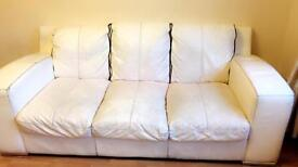 White leather 3 seater and 2 seater sofa set.£20 for both of them
