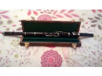 silver key wooden flute in key of D.