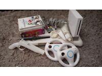 Nintendo Wii Console bundle w/ 5 games, 2 wheels and gun accessory