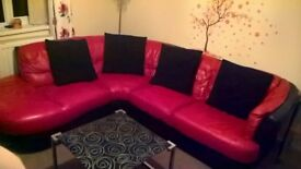 Beautiful red and black leather corner with chair