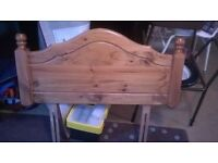 Single bed with timber headboard