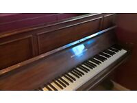 Upright metal frame piano
