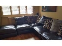 Black leather corner sofa (can be used left or right) with matching footrest - excellent condition