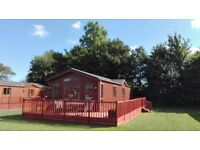 6 berth woodland holiday lodge for sale at Yaxham Waters Holiday Park in rural Norfolk Free fishing
