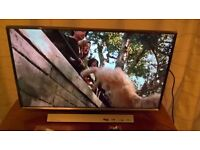 """Brand new Samsung 32"""" led TV with remote, stand and manual."""