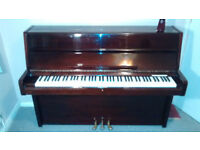 Reidsohn upright piano and piano stool in excellent condition.