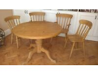 Solid pine adjustable table with 6 matching chairs