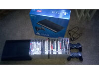 Playstation 3 superslim 320gb hard drive with 24 games 2 controllers excellent condition