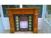CAST IRON FIREPLACE WITH SOLID WOOD SURROUND
