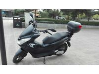 HONDA PCX 125,BLACK, EXCELLENT CONDITIONS, JULY 2014,VERY LOW MILEAGE