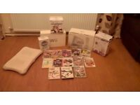 Wii console bundle including 15 games, wii fit board, 2 controllers, nunchuck and a few accessories