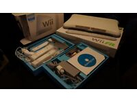 Nintendo Wii & WiiFit board, 2 motion plus controllers, 1 normal controller, 1 nunchuck,