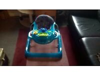 Mothercare baby walker, height adjustable with toy tray.