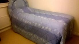 Single Divan Bed with headboard and matching bedcover.