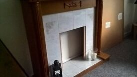 Wood Fire Surround, grey tiled back.