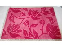 Beautiful red floral pattern rug