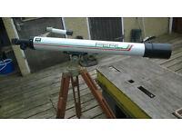 Telescope on wooden tripod